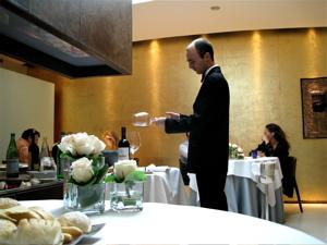 I - waiter warming wine glass