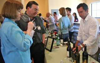 Acme - Winemaker Andy Erickson pours for guests