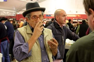 Truffles - man with hat, smelling truffles at 350 dpi