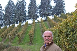 Malvira – Roberto Damonte, standing in the Renesio vineyard