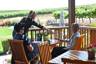 A - Bouchaine, Lisa Brown pours for guests on patio