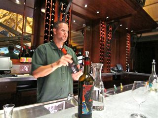 A - Coppola - Neal Coats pours wine