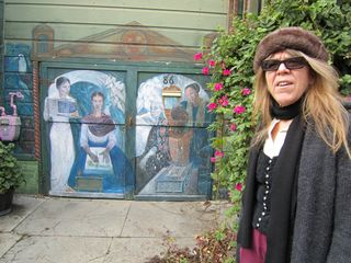 A - Murals - CU Pastricia and painted mural behind her