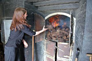 A - Scotland - tossing peat on fire, Laphroaig