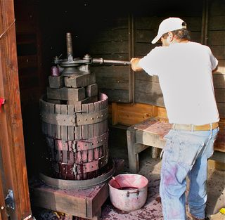 A - Tra Vigne- Hand-pressing the juice with wooden basket press at Charter Oak