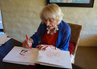 A - Margrit - signing books