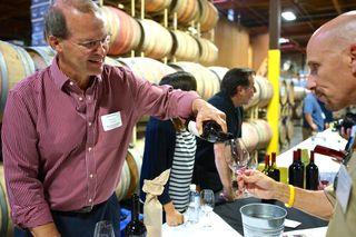 Rutherford - Charles Thomas, winemaker at Quintessa, pours for Rick Kushman of Capital Public Radio