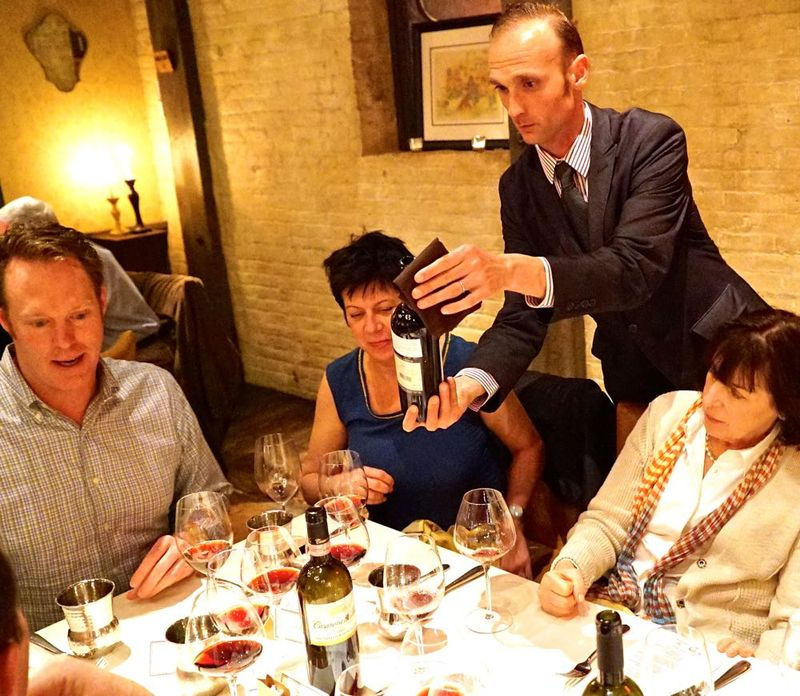 Massi pours one of the five wines of the night for guests