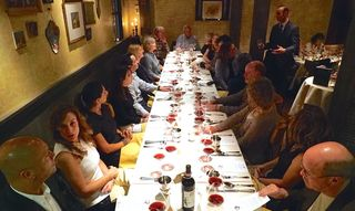 One of the four tables hosting 44 dinner guests