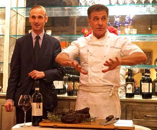 Massi and Chef kibbutz around while showing how to carve bistecca