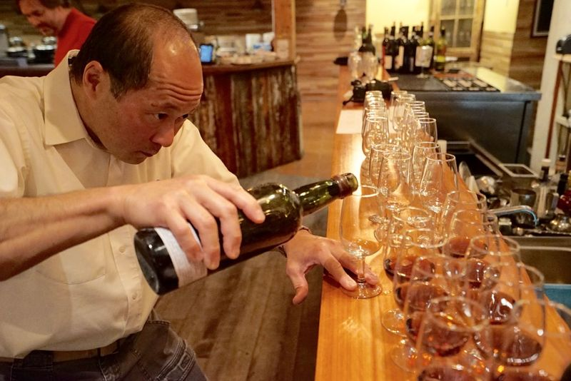Eric Ifune pours
